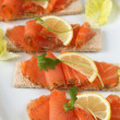 Smoked salmon snacks — Stock Photo