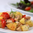 Fried potatoes with mushrooms and cherry tomatoes - Stock Photo