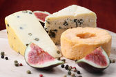 Cheese board with figs — Stock Photo