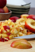 Chopping nectarines — Stock Photo