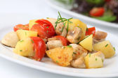 Fried potatoes with mushrooms and cherry tomatoes — Foto de Stock