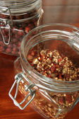 Dried rose hips in glass jars — Stock Photo
