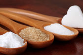 Sugar in wooden spoons — Stock Photo