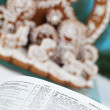 Bible and Gingerbread Nativity scene - Stock Photo