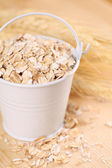 Oats in a small bucket — Stock Photo