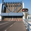 opened bascule bridge in the netherlands with red stop sign — Stock Photo