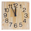 Wooden clock saying five to twelve — Stock Photo