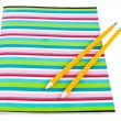 Stock Photo: Colorful exercise book with wooden pencils