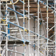 Scaffolding at building site of concrete construction — Zdjęcie stockowe #7490235