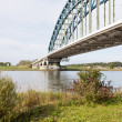 Old iron bridge crossing the river IJssel, the Netherlands — 图库照片