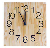 Wooden clock saying five to twelve — Stockfoto