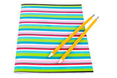 Colorful exercise book with wooden pencils — Stock Photo