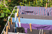 Drying frame with clothes in the garden — Stock Photo