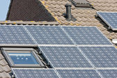 Home with roof and solar panels — Stock Photo