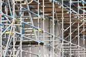 Scaffolding at a building site of a concrete construction — Stock Photo