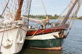 Bow of two old schooners in Dutch harbor Kampen — Stock Photo