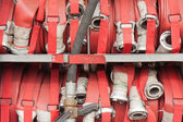 Lapped fire hoses on a fire truck — Stock Photo