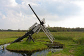 Typical Dutch agrarian windmill for dry milling of farmland — Stock Photo