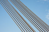 Set of steel cables against a blue sky — Stock Photo