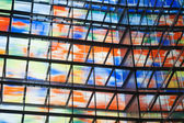 Many colored windows inside a modern building — Стоковое фото