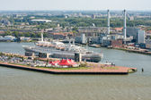 Aerial view of Dutch harbor Rotterdam with a big passenger ship — Stock Photo