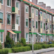 Typical Dutch residential street with flats - Stock Photo
