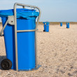 Stock Photo: Big blue dust bins at beach