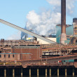 Steel factory with smokestack — Stock Photo