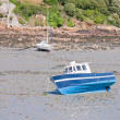 Small boats at ebb tide waiting for rising water — Stock Photo #7519137