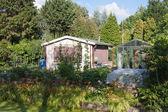 Garden house in a green environment — Stock Photo