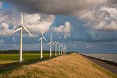 Dutch Windturbines and a cloudscape in the last sunlight of a su — Stock Photo