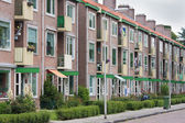 Typical Dutch residential street with flats — Stock Photo