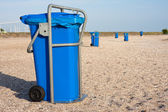 Big blue dust bins at the beach — Stock Photo