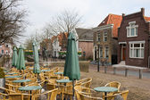 Empty terrace in an old traditional Dutch village — Stock Photo