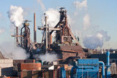 Steel factory with smokestacks — Stock Photo