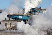 Portal Crane with many clouds of steam — Stock Photo