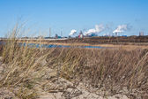 Dutch steel factory seen from the dunes along the coast — Stock Photo