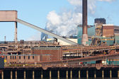 Steel factory with smokestack — Stockfoto
