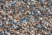 Colored pebbles at the beach — Stock Photo