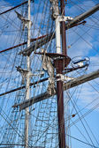 Two masts with rigging of big sailing vessels — Stock Photo