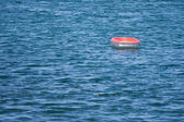 Lonely rowboat in the wide sea — Stock Photo