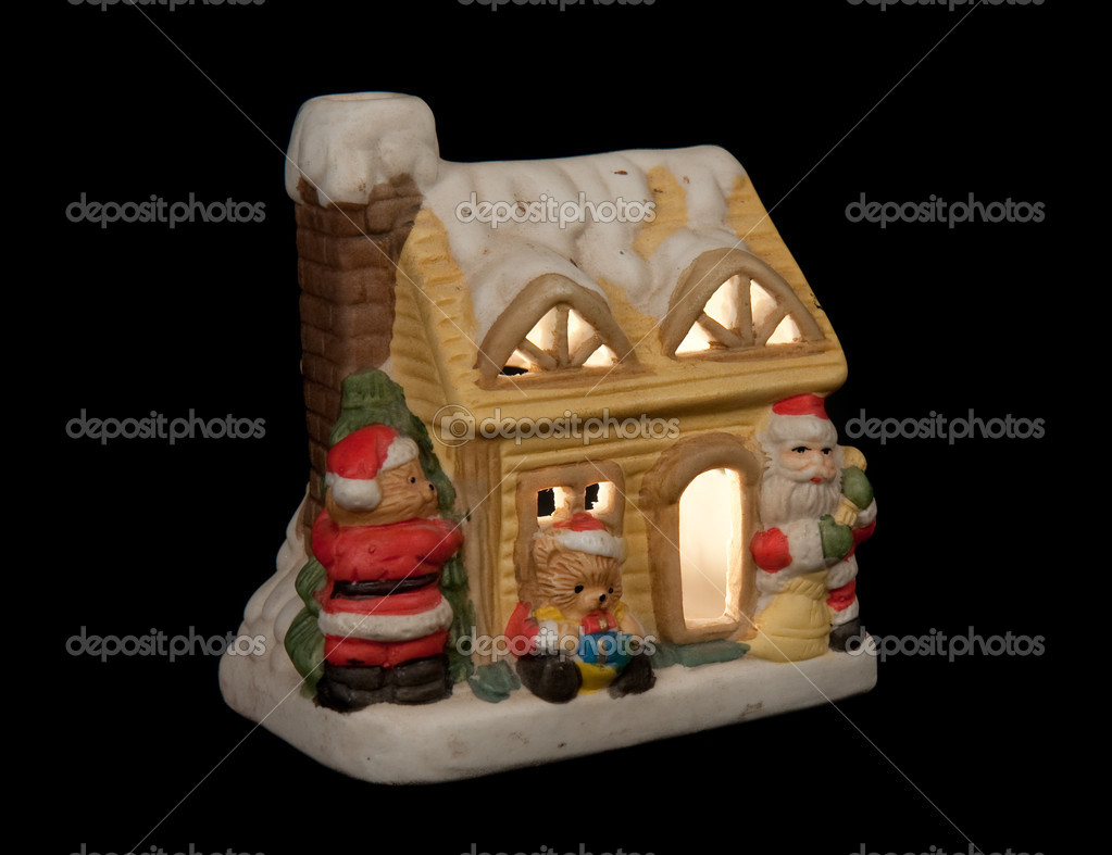 Small christmas house with a candle inside, isolated on a black background — Stock Photo #7517301