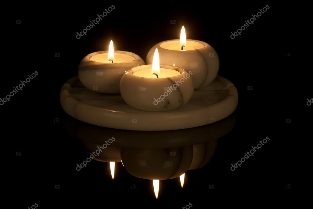 Decorative candlestick of marble with three lights at a black background — Stock Photo #7517304
