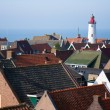 View at the lighthouse and roofs of an old fishing village in th — Stock Photo