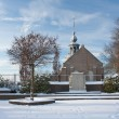 Old Dutch church with graveyard in winter — Stock Photo