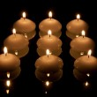 Nine candles in the dark — Stock Photo