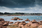Rocky coast of Brittany with threatening thunderstorm, France — Stock Photo