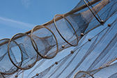 Fishnet drying in the sun against the blue sky — Stock Photo