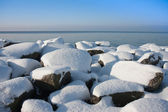 Rocks of Dutch breakwater in wintertime — Stock Photo