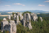 Sandstone pillars arising above the wood in the Czech republic — Stock Photo